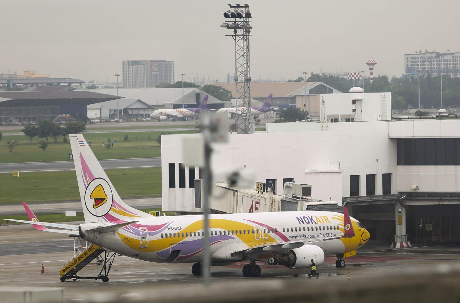 An aircraft of Nok Air is parked at Don Mueang Airport during the outbreak of Covid-19. Pattarapong Chatpattarasill