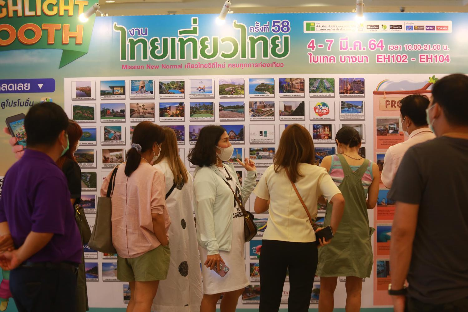 Visitors check out travel promotions at the 58th Thai Tiew Thai travel fair, which kicked off yesterday at Bitec Bangna. (Photo by Somchai Poomlard)