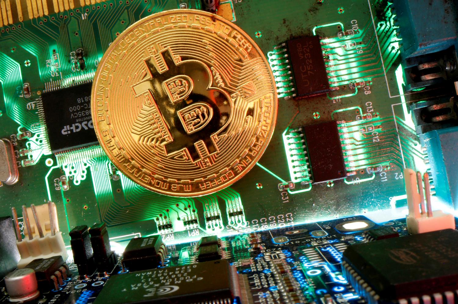 A representation of bitcoin on a motherboard in an illustration. Proposed SEC rules for trading cryptocurrency have Thais upset.(Reuters photo)