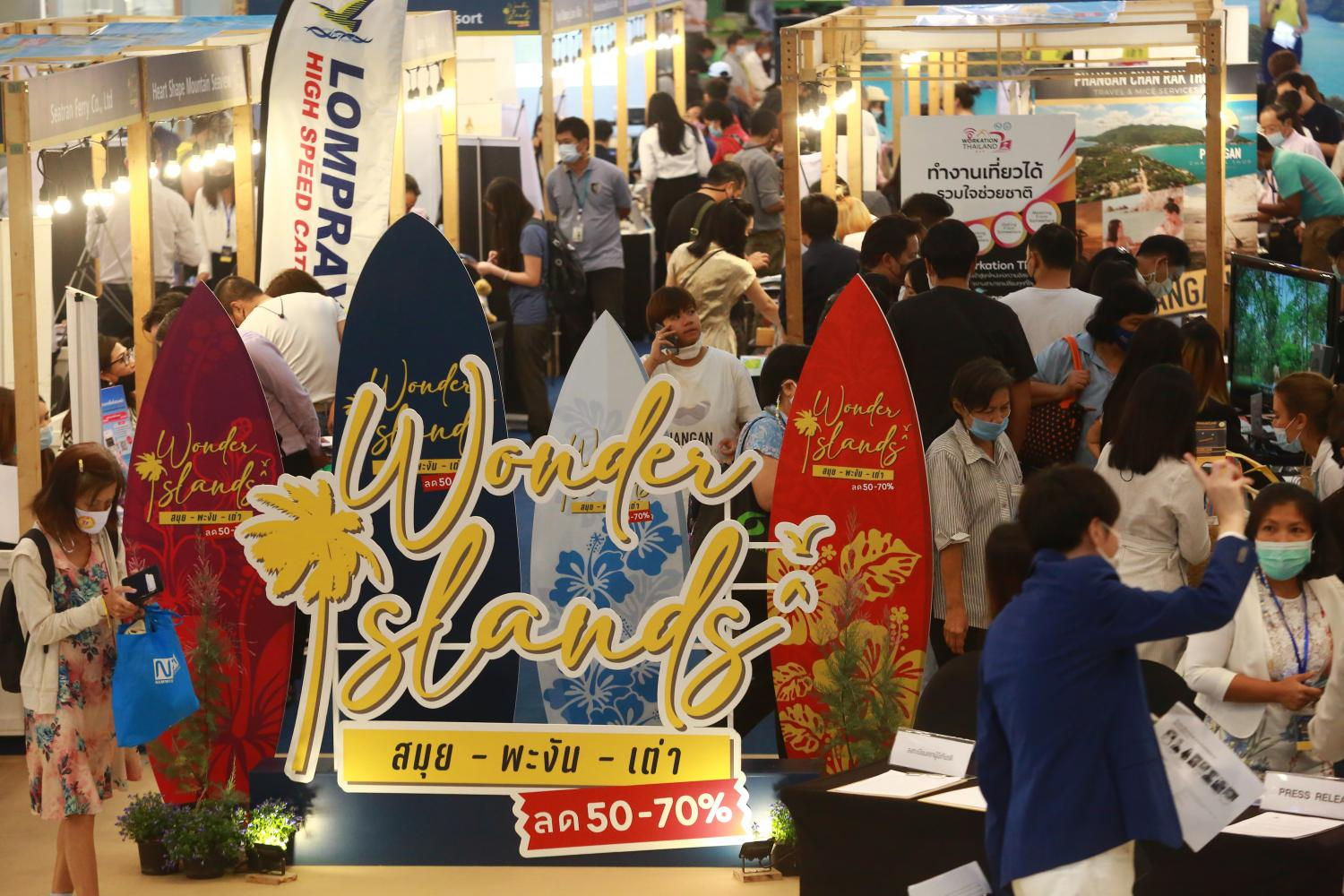 The festive atmosphere as consumers look for travel deals at the 'Wonder Islands Samui, Phangan, Tao' event that started on Thursday at CentralWorld, Eden Zone, 1st floor.Somchai Poomlard