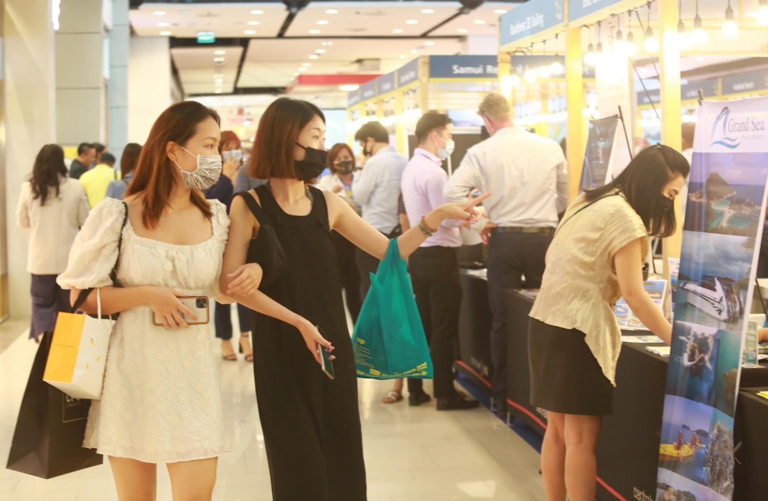 Visitors browse travel deals offered at the 'Wonder Islands Samui, Phangan, Tao' event, which runs from March 11-17 at CentralWorld.