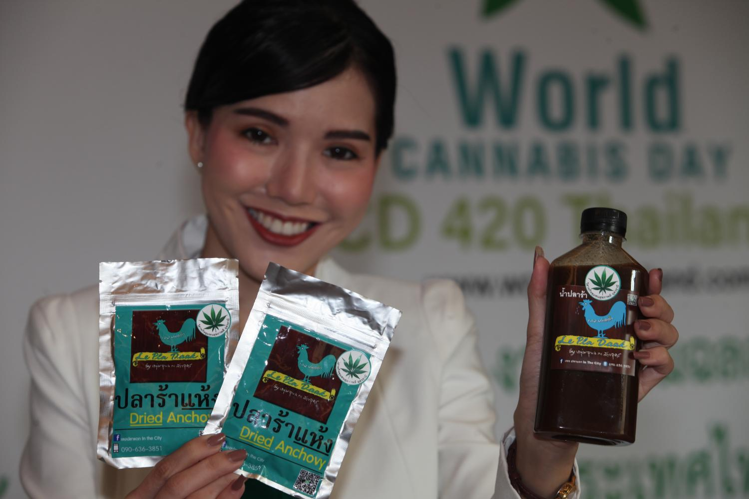 A presenter shows off dried anchovy and fermented fish sauce products that use cannabis as an ingredient at a press conference at an event to mark World Cannabis Day and the 420 days that have passed since medical cannabis use was legalised in the country.  Apichart Jinakul