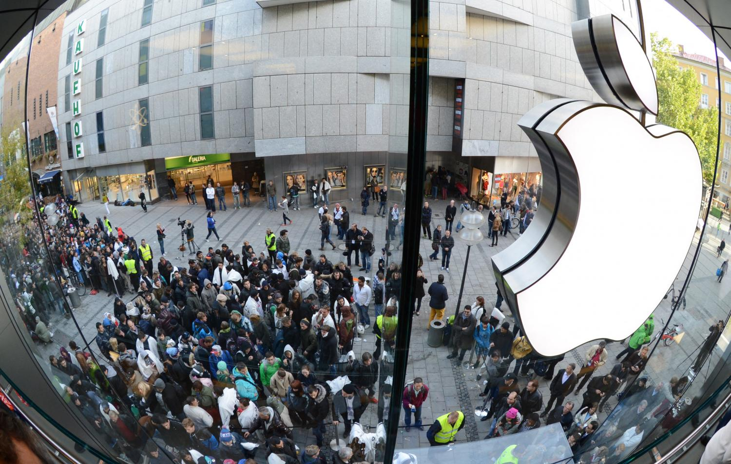 This file photo shows customers queueing to enter the Apple Store in Munich.AFP