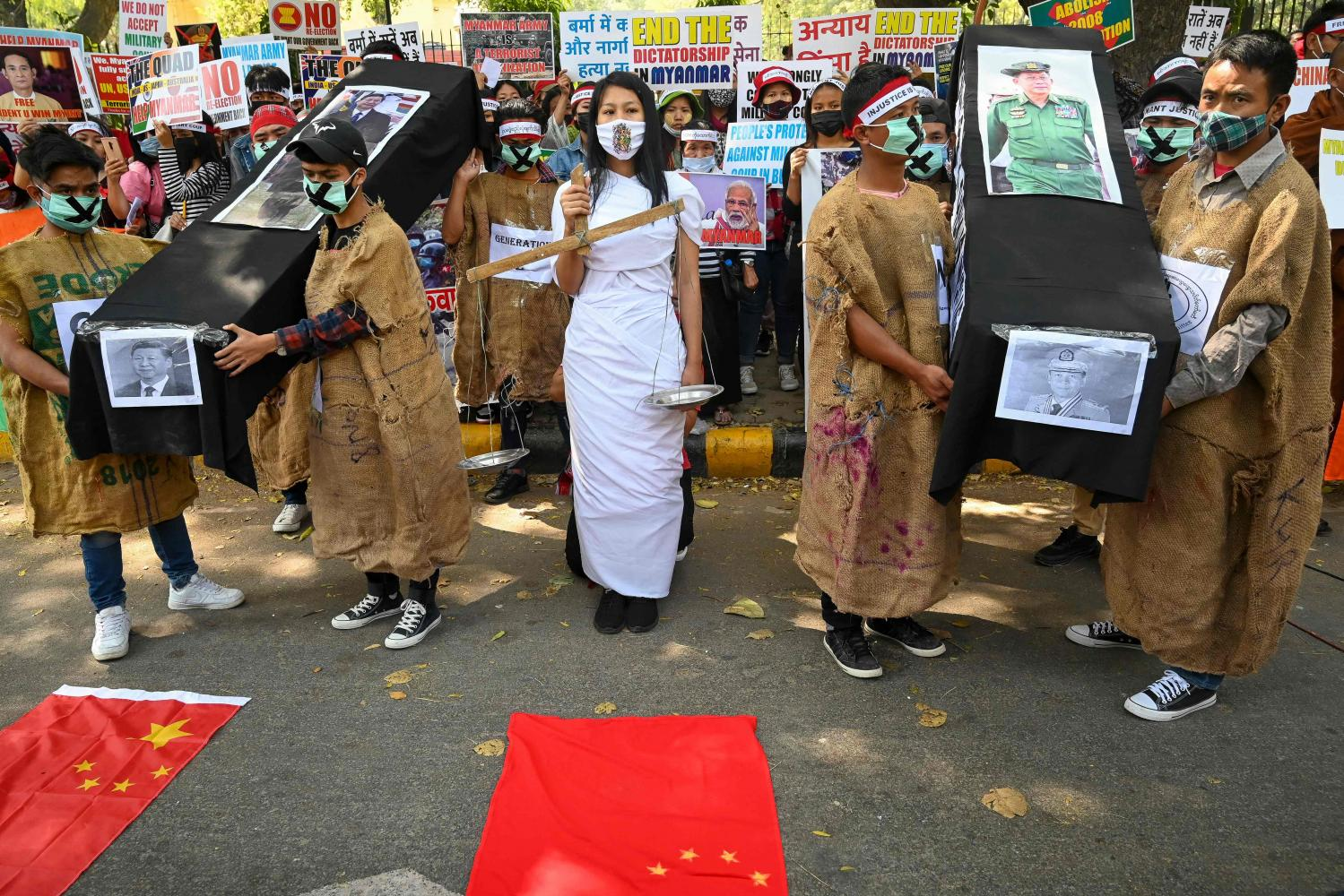 Protesters hold coffins displaying a picture of Chinese President Xi Jinping, left, and Myanmar military chief Senior General Min Aung Hlaing during a demonstration in New Delhi on March 3, to protest against the military coup in Myanmar.AFP