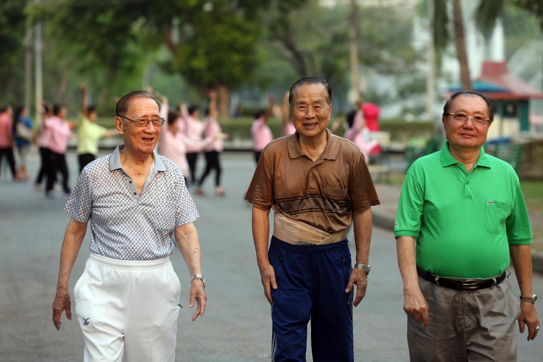 Senior citizens exercising at Lumpini Park in Bangkok.(Photo by Weerawong Wongpreedee)