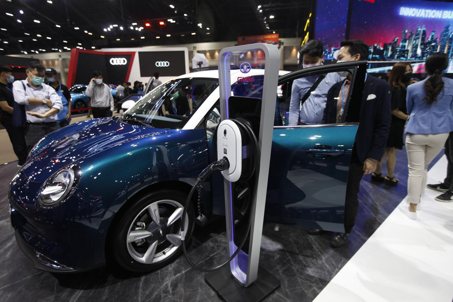 Visitors browse electric vehicles displayed at the 42nd Bangkok International Motor Show, which takes place at Impact Muang Thong Thani until April 4. (Photo by Varuth Hirunyatheb)