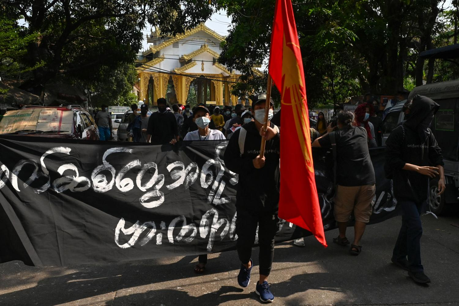 Protesters take part in a demonstration against the military coup in Yangon's Kyimyintdine township on April 1.(AFP photo)