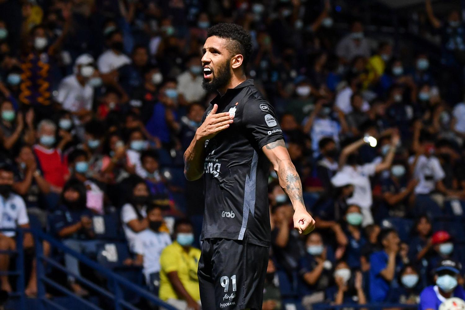 Buriram United's Samuel Rosa reacts after scoring against Muang Thong.