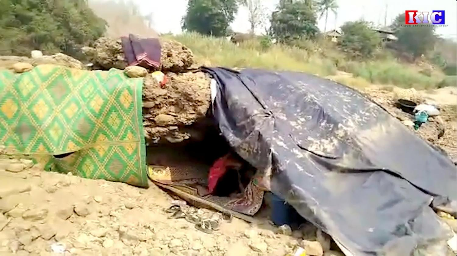 People hide under rocks following an airstrike, in Papun district, Karen state, Myanmar last Friday in this still image obtained from a social media video. Reuters