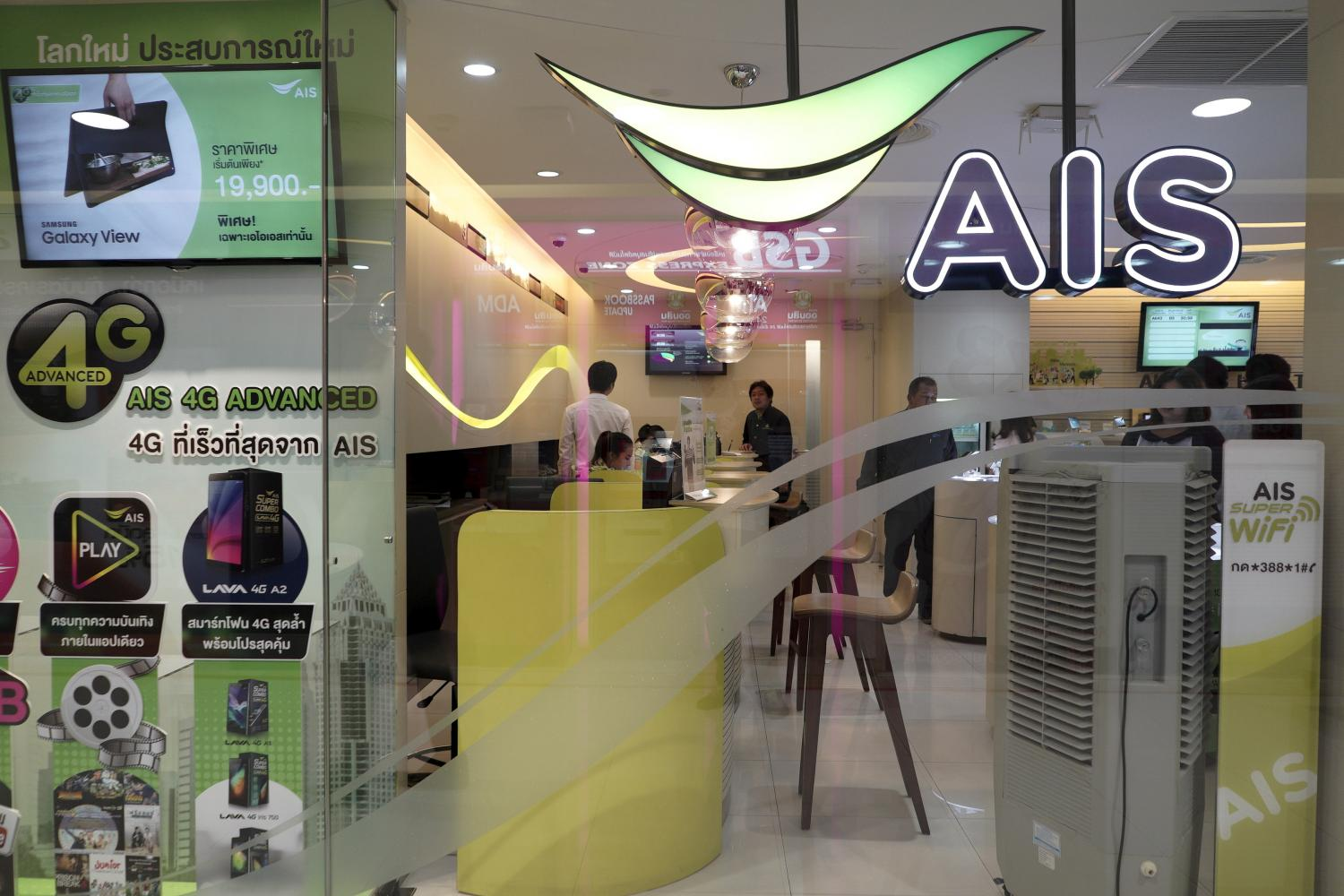 Customers wait for service at an AIS shop in Bangkok.(Reuters photo)