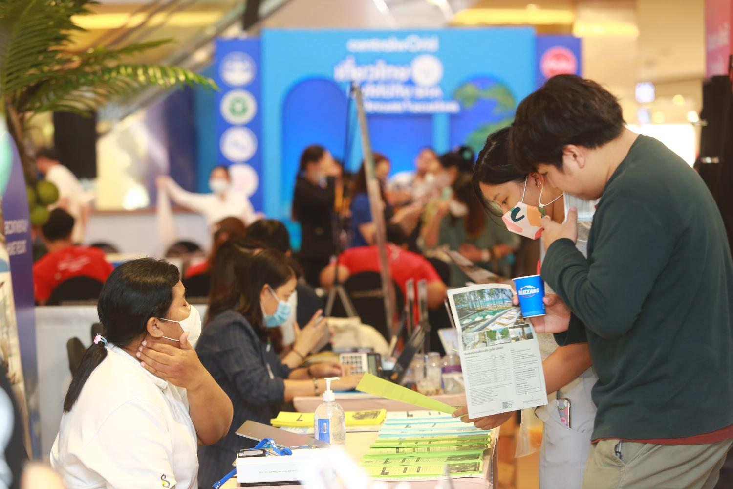 People browse deals at a Bangkok travel fair. A THA survey in March showed revenue for most properties had still not recovered. (Photo by Somchai Poomlard)