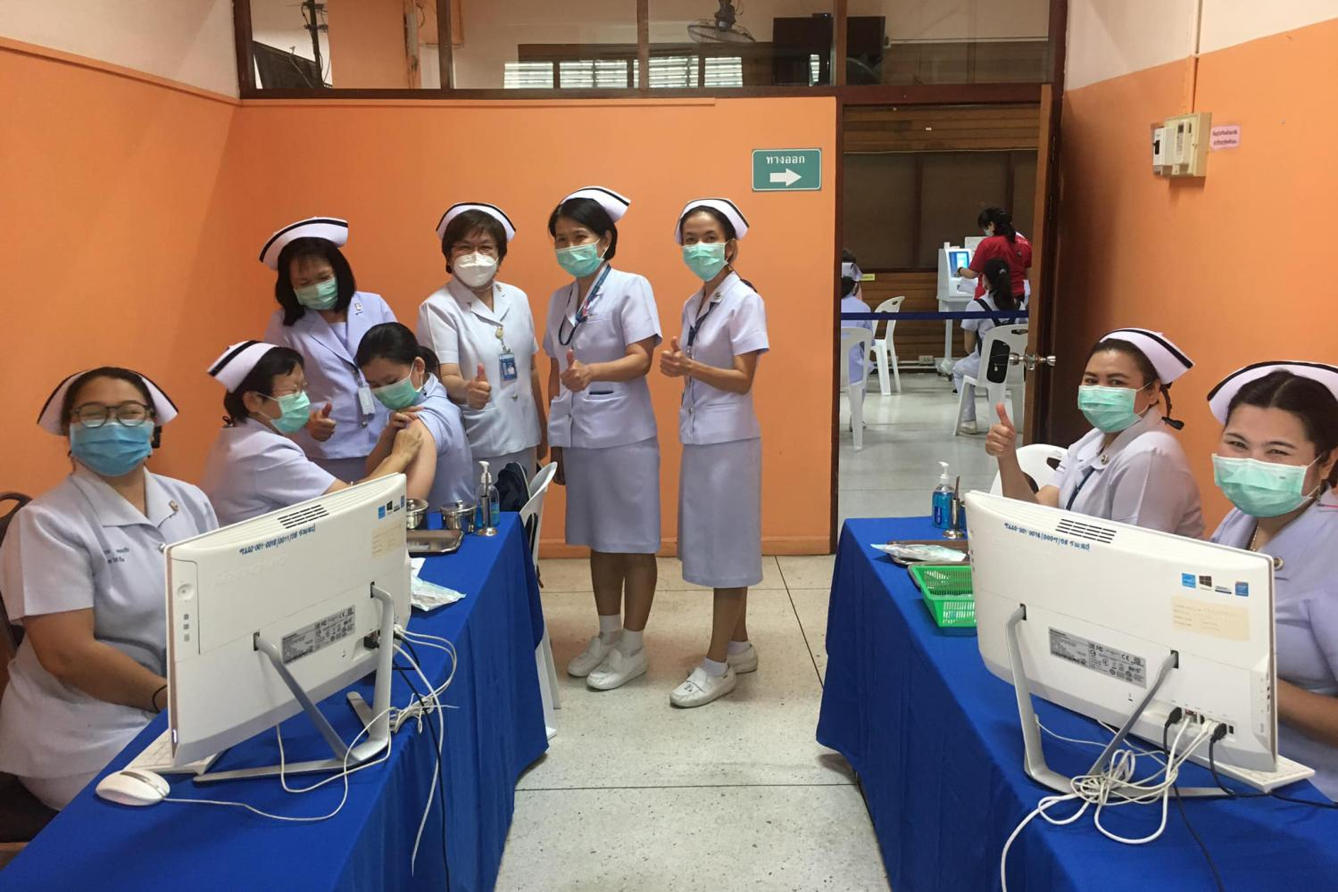 A group of nurses pose during Lampang's Covid-19 vaccination drive. The province began its vaccination drive earlier this month but the campaign was paused after reports of side effects. (Photo By Lampang Hospital)