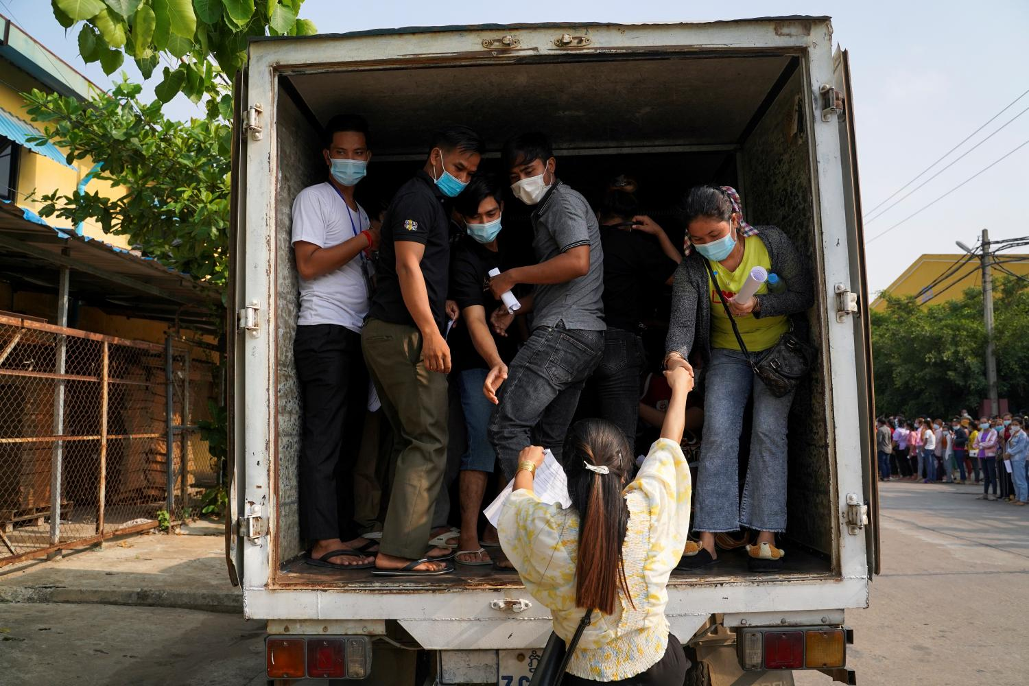 Garment factory workers and staff arrive to receive China's Sinovac coronavirus disease vaccine at an industrial park in Phnom Penh, Cambodia, in April.(Photo: Reuters)