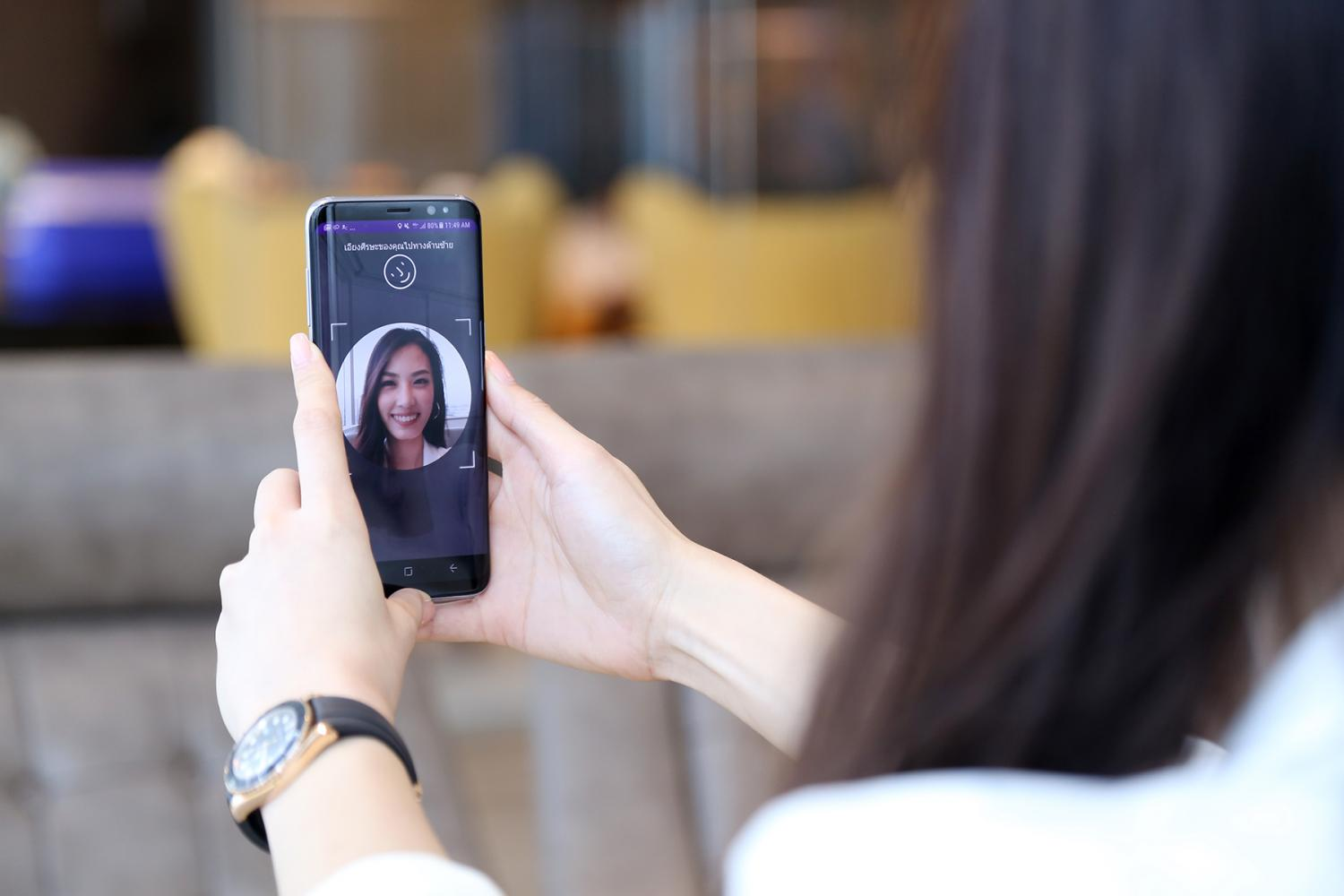 A mobile screen displays a bank's digital know-your-customer feature which allows new bank accounts via facial recognition. Most Thais are open to providing their bank with a biometric such as a facial scan, fingerprint or voiceprint to secure their accounts.