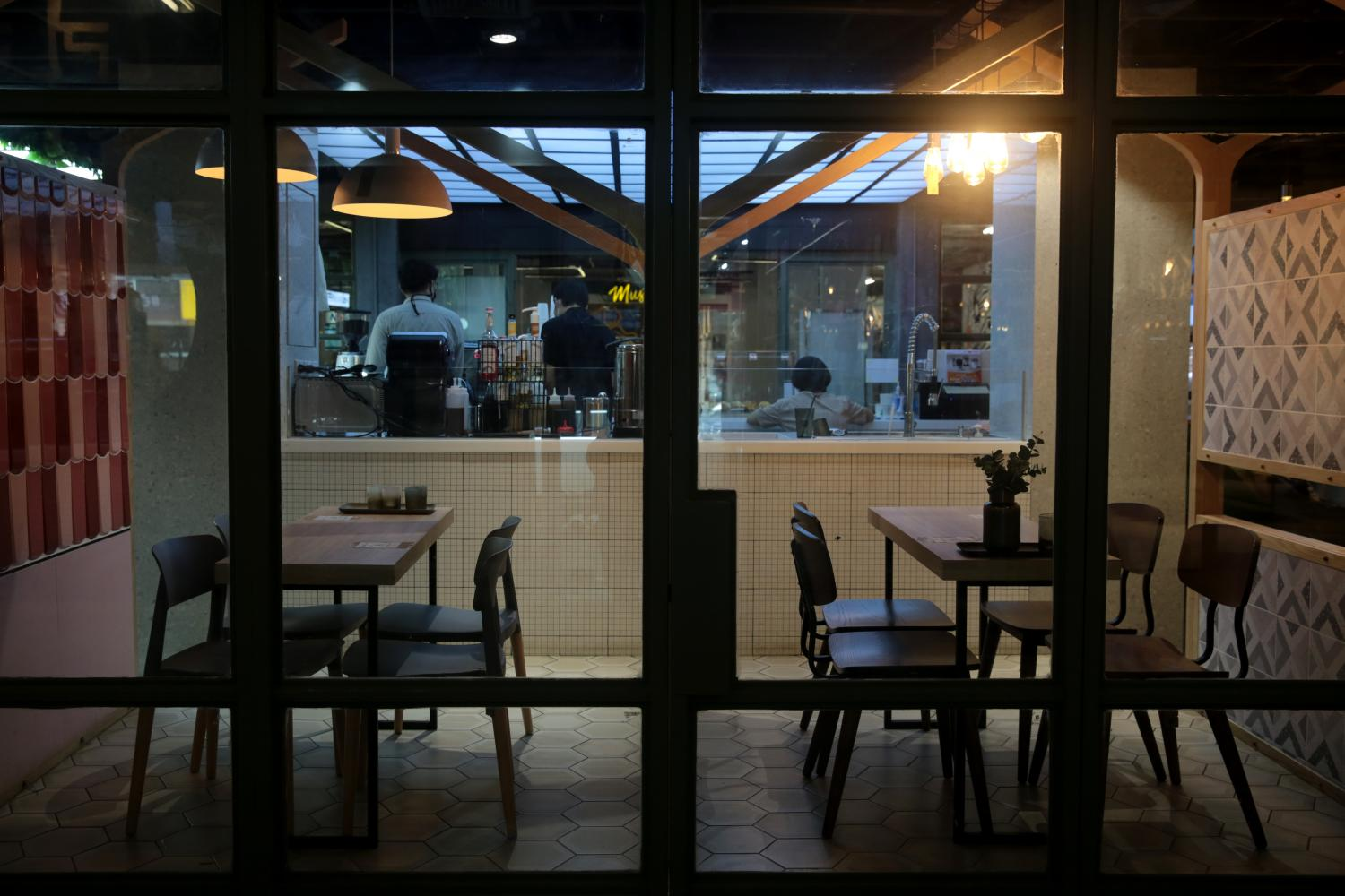 A restaurant in Siam Square is deserted as most people work from home and are banned from dining at eateries.(Photo by Chanat Katanyu)