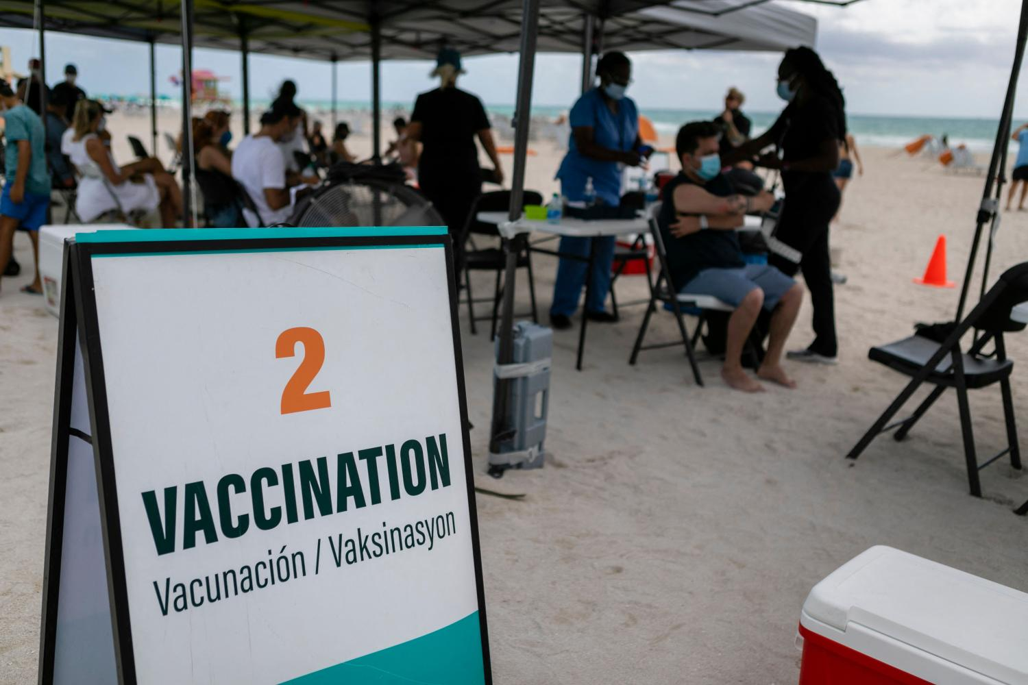 People get a Johnson & Johnson Covid-19 vaccine at a pop-up vaccination centre in South Beach, Florida on Sunday.(Photo: AFP)