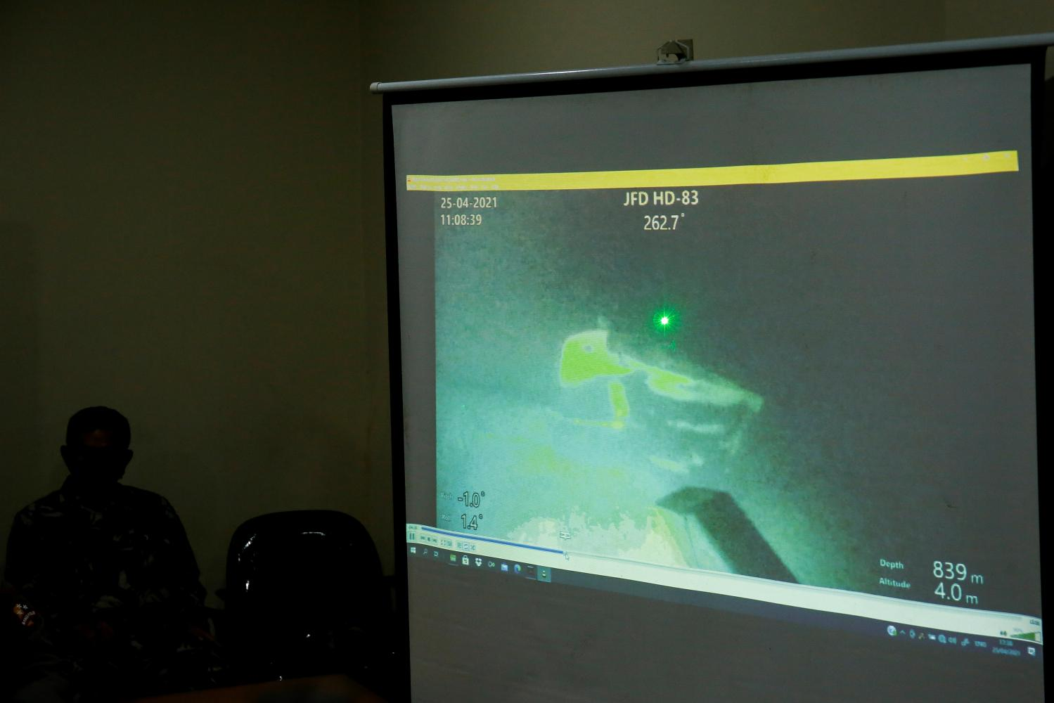 An Indonesian military personnel displays a clip showing the wreckage of the sunken Indonesian Navy KRI Nanggala-402 submarine on April 25.REUTERS