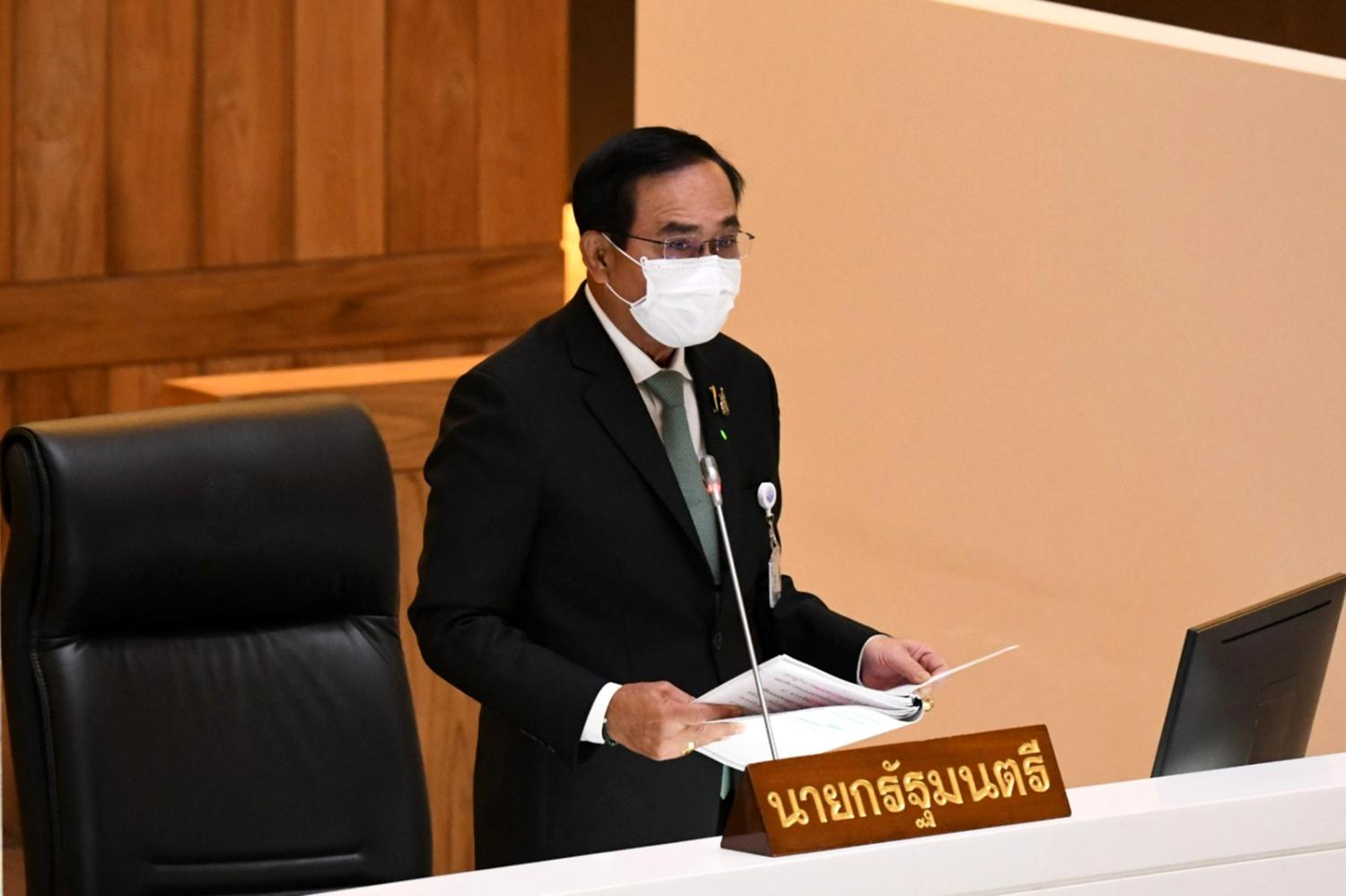 Prime Minister Prayut Chan-o-cha presents the 3.1-trillion-baht budget for the 2022 fiscal year to the Lower House on Monday.(Parliament photo)