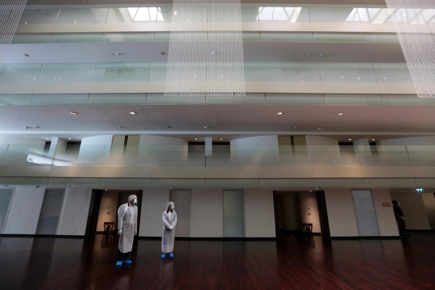 Healthcare workers are seen in PPE suits at the Movenpick BDMS Wellness Resort Bangkok which serves as an alternative state quarantine facility.Chanat Katanyu