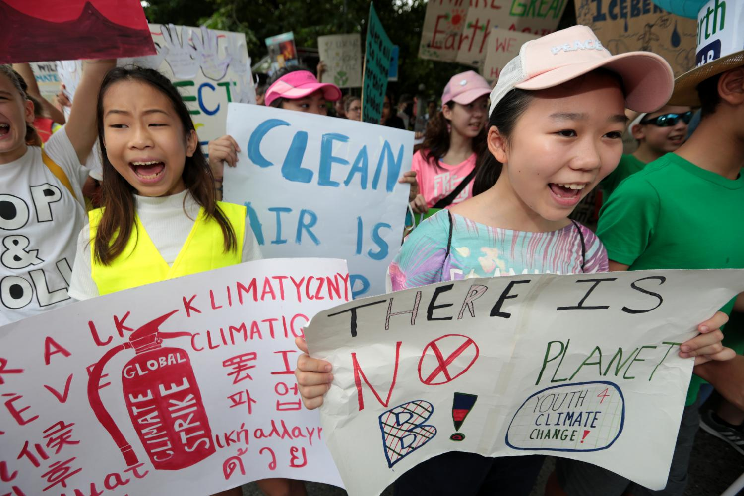 Young people carrying placards highlighting their concerns about climate change march to the Natural Resources and Environment Ministry to urge the government to take action.(Photo: Chanat Katanyu)
