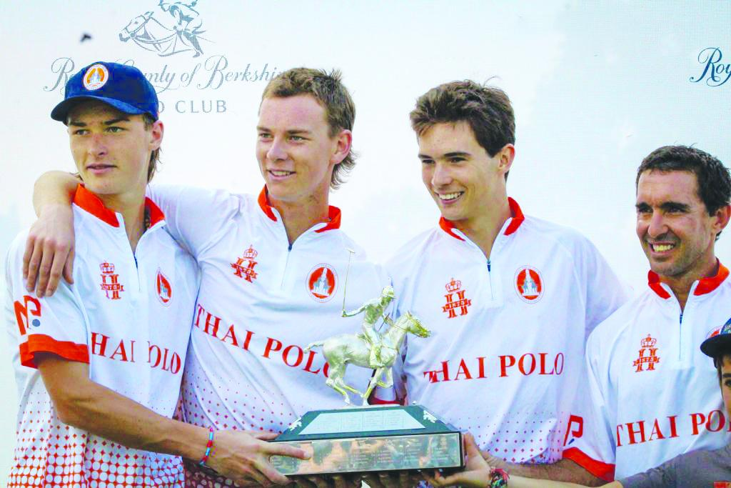 Thai Polo team members, from left, Louis Hine, Ned Hine, Rufino Bensadon and Alejandro Muzzio celebrate with the Prince of Wales Trophy.