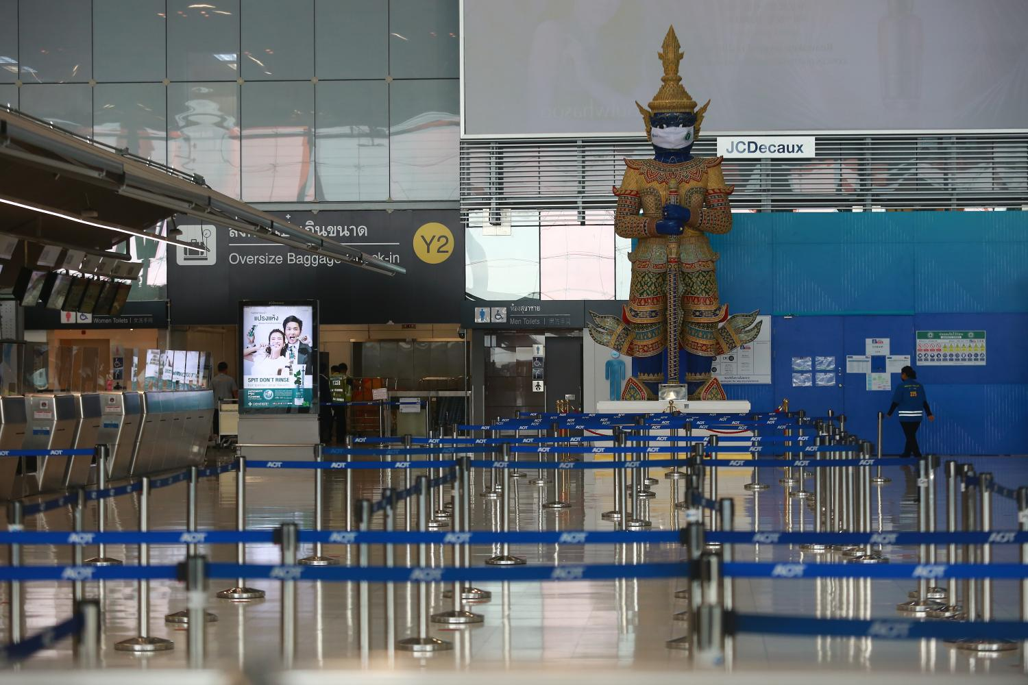 The passenger terminal at Suvarnabhumi airport is virtually deserted with a fall in tourists amid the third wave of Covid-19. Fitch forecasts Thailand's tourism-dependent economy will recover only modestly, by 1.8% this year, following a 6.1% contraction in 2020.Somchai Poomlard