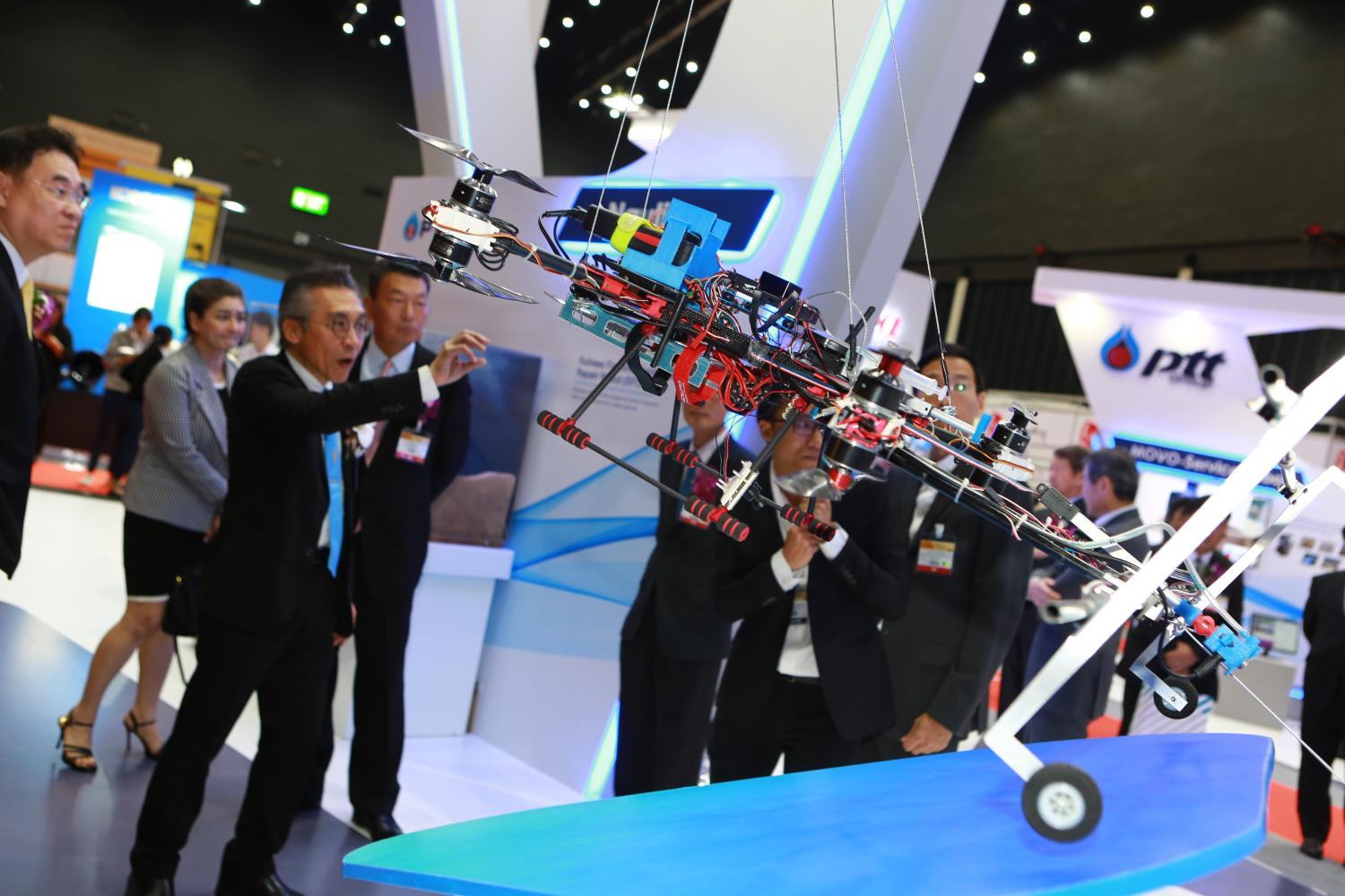 People at 'Maintenance & Resilience Asia 2019' show an underwater robot capable of fixing petroleum pipelines, in Bangkok.Somchai Poomlard
