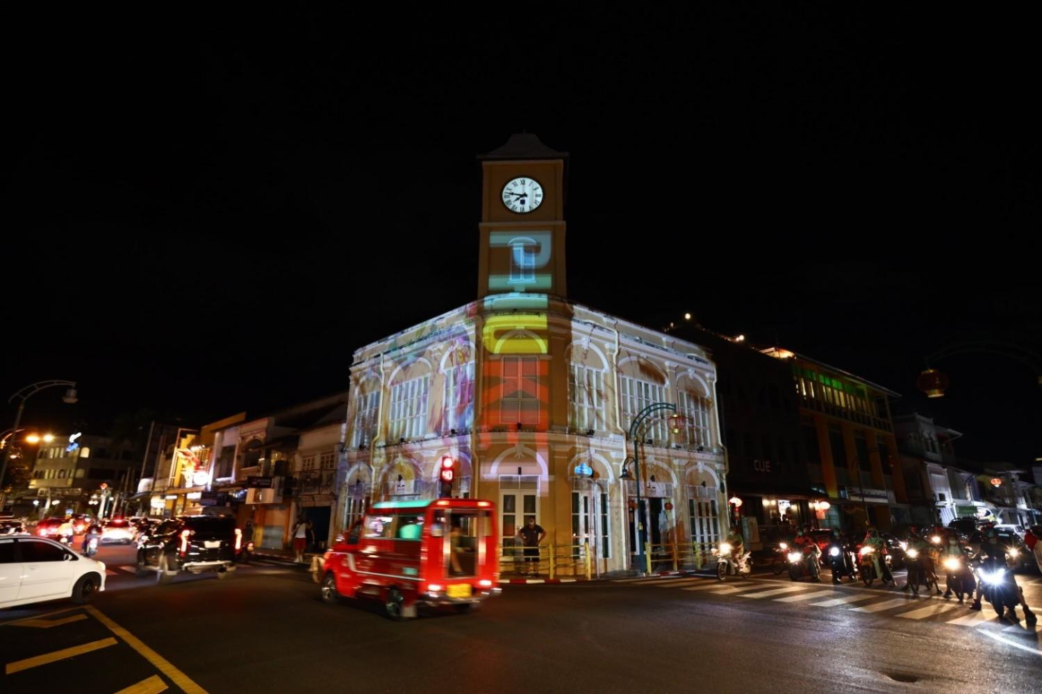The clock tower in Phuket's old town is illuminated during the reopening of the island under the sandbox scheme.