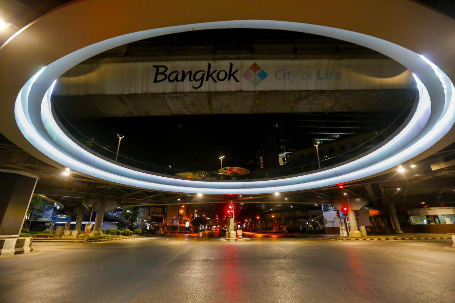 The Pathumwan intersection and its skywalk is void of traffic and people during the lockdown hours in the capital. Pattarapong Chatpattarasill