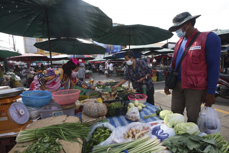 A vegetable vendor sells fresh produce at a fresh market in Nonthaburi.Pattarapong Chatpattarasill