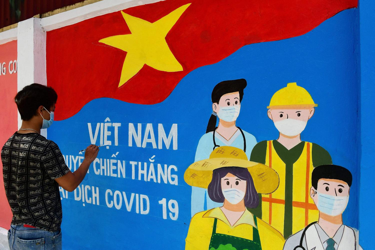 A mural depicting coronavirus frontline workers along a street in Hanoi. The US sent Vietnam 2 million Moderna vaccine doses on July 6.AFP