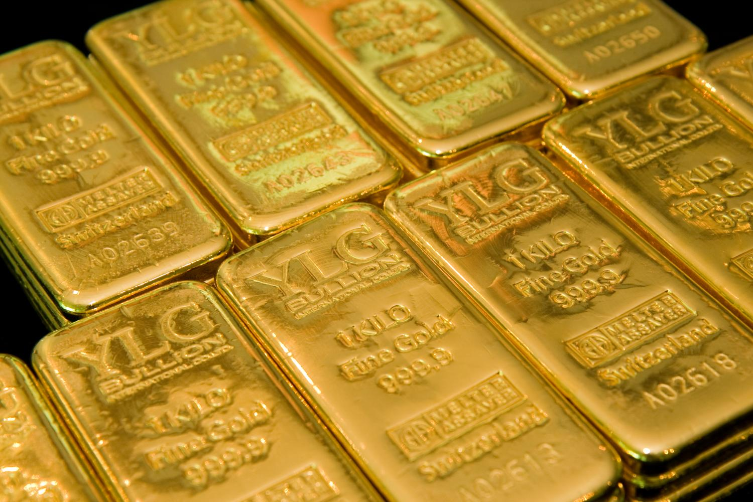 Bars of gold are arranged for a photograph at the headquarters of YLG Bullion International in Bangkok.