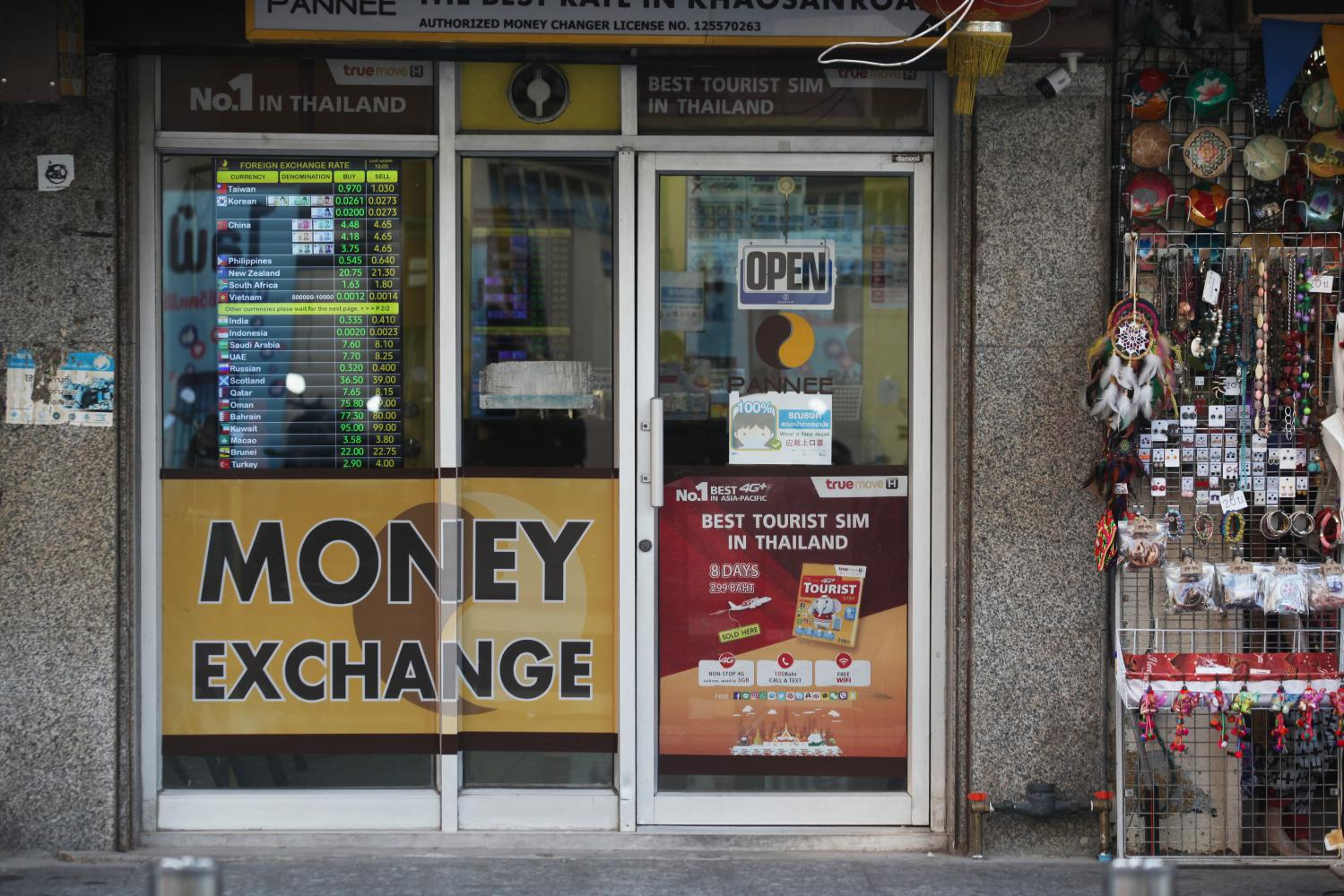 A forex kiosk on Khao San Road in Bangkok. The baht has plunged in the past two months. (Photo: Nutthawat Wicheanbut)