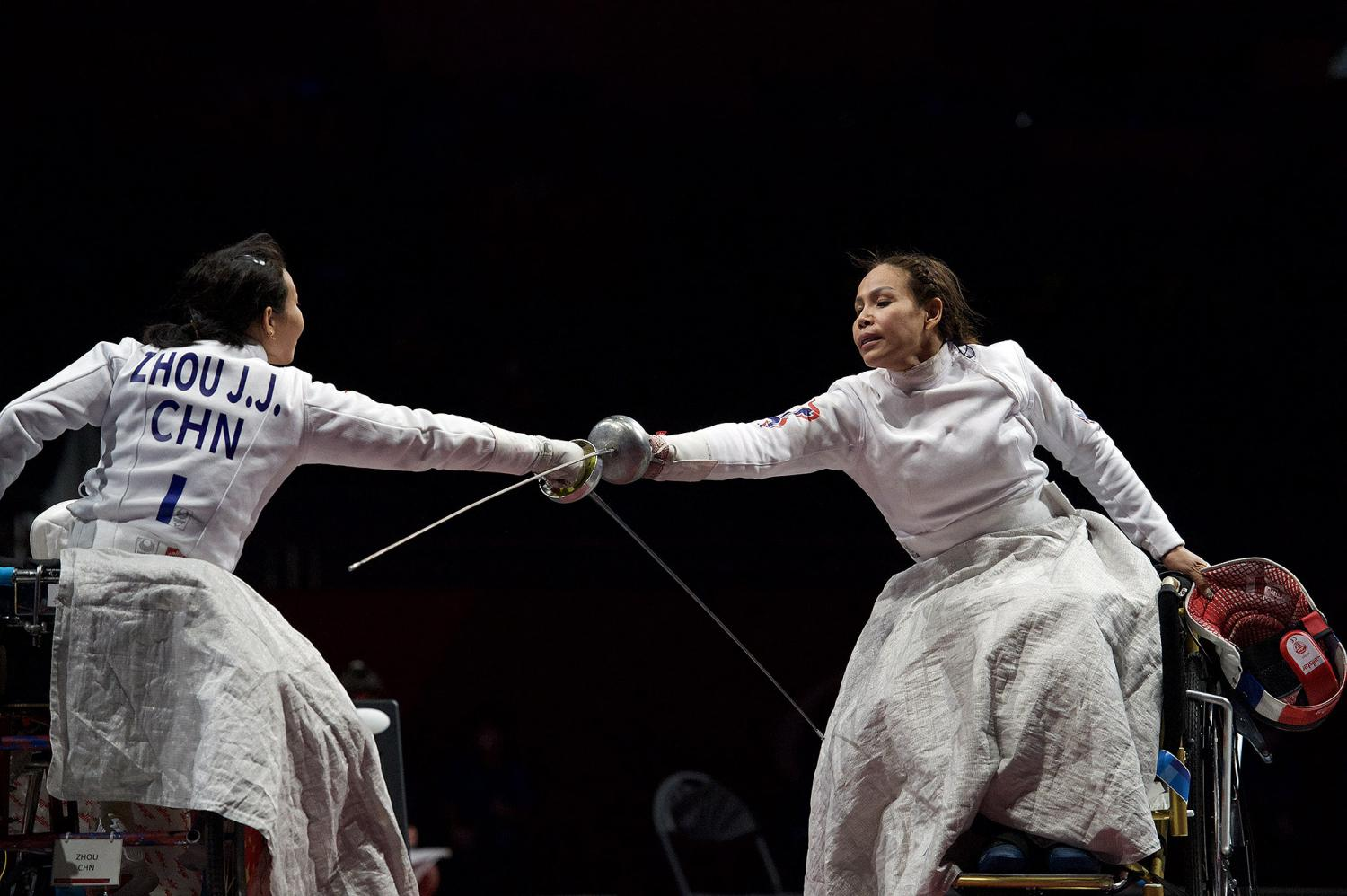 China's Zhou Jingjing (left) congratulates Thai wheelchair fencer Saysunee Jana on her victory in the bronze medal match in the women's epee individual category B event at the Tokyo Paralympics on Thursday.