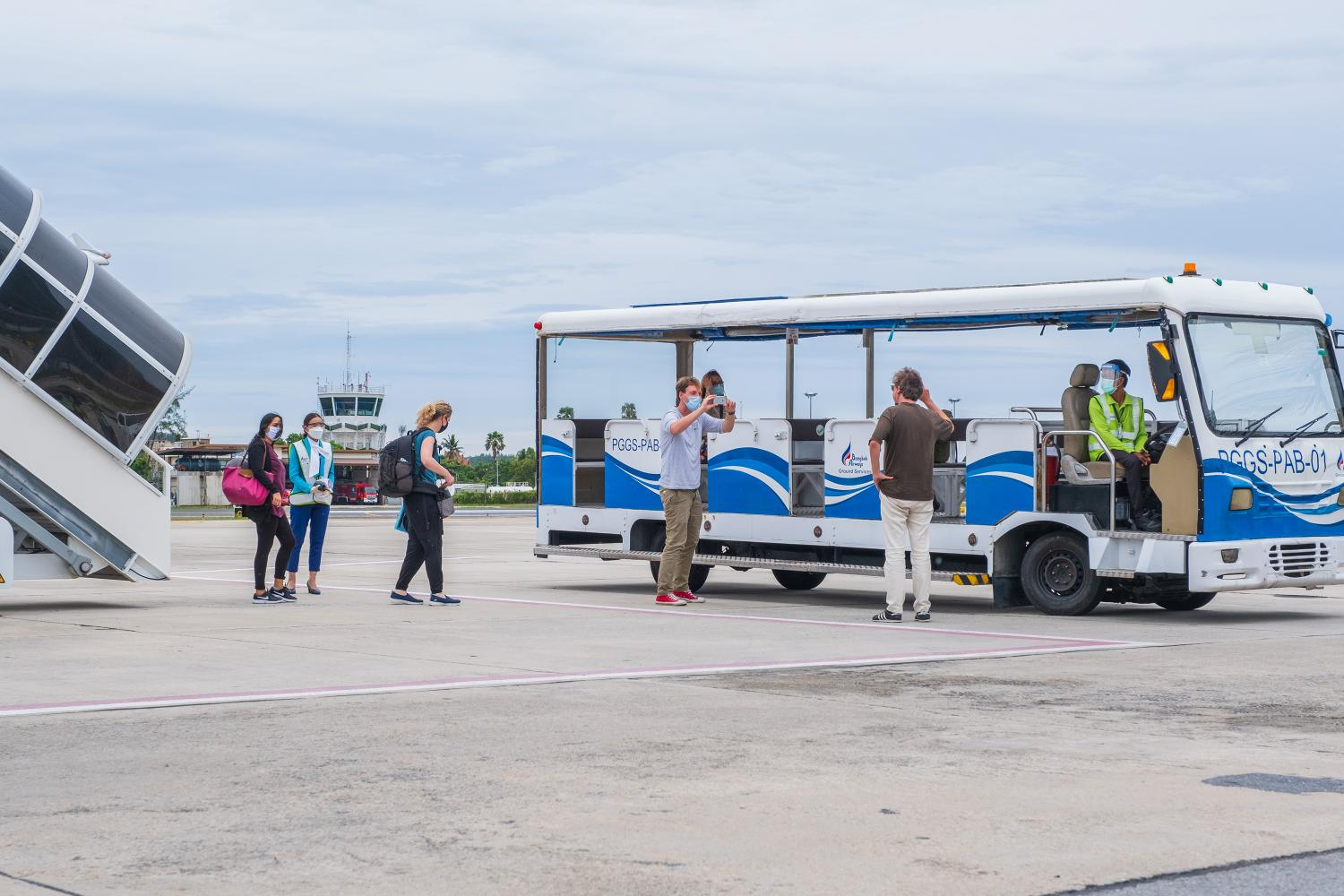 Passengers arriving under the Samui Plus travel scheme on July 15 catch a shuttle to the main building at Koh Samui airport.