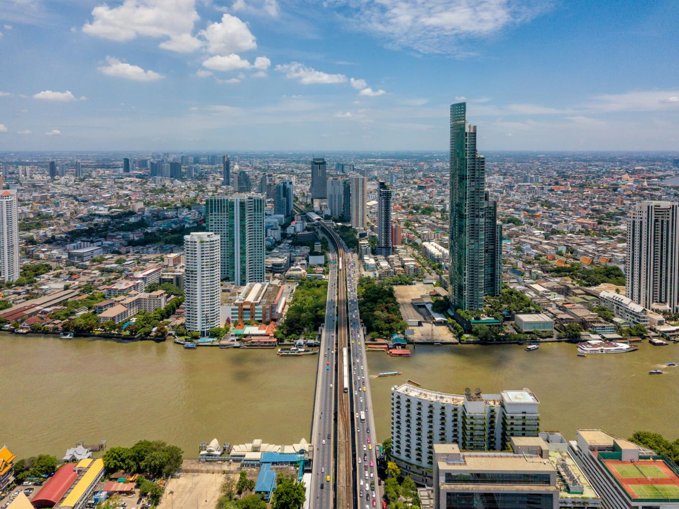 The Bangkok skyline as seen from above Saphan Taksin skytrain station. Ms Neeranuch says Bangkok condos remain at the forefront of foreigners' minds for their second-home plans.