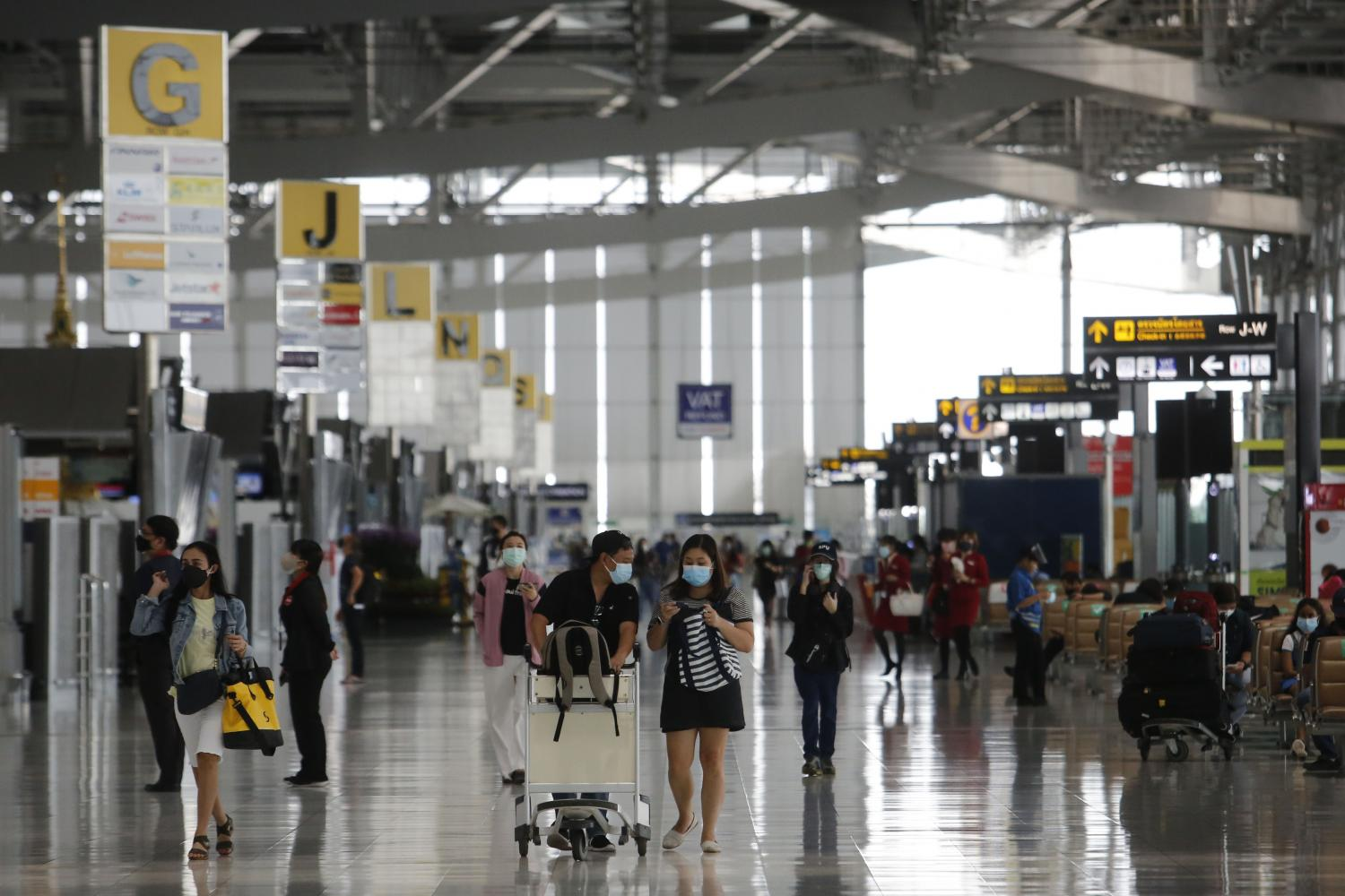 The atmosphere at Suvarnabhumi airport as domestic flights originating from dark red zones were approved to resume on Wednesday.Wichan Charoenkiatpakul