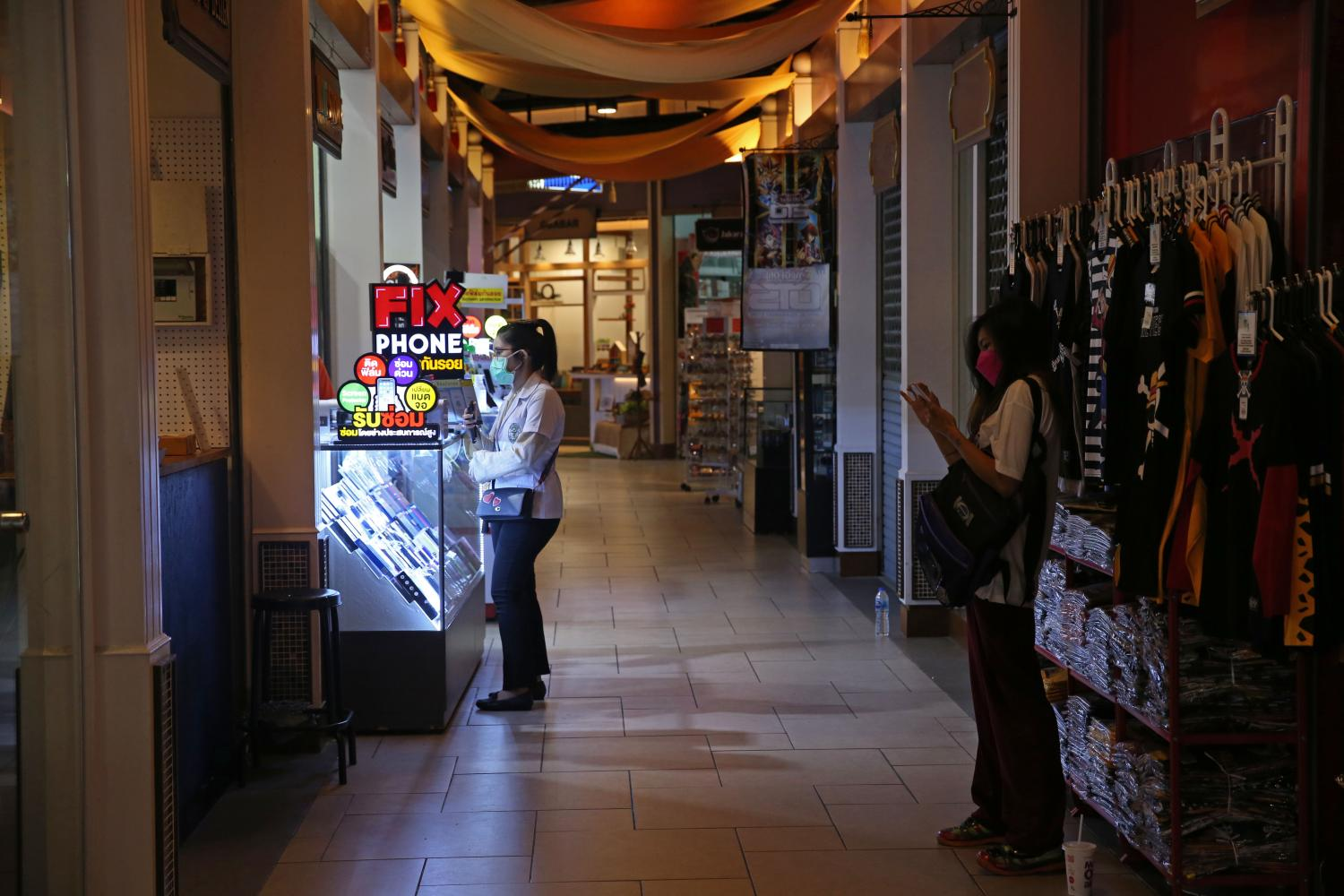 Traffic is sparse at Terminal 21 mall in Bangkok as some shops are still temporarily closed because of the pandemic.