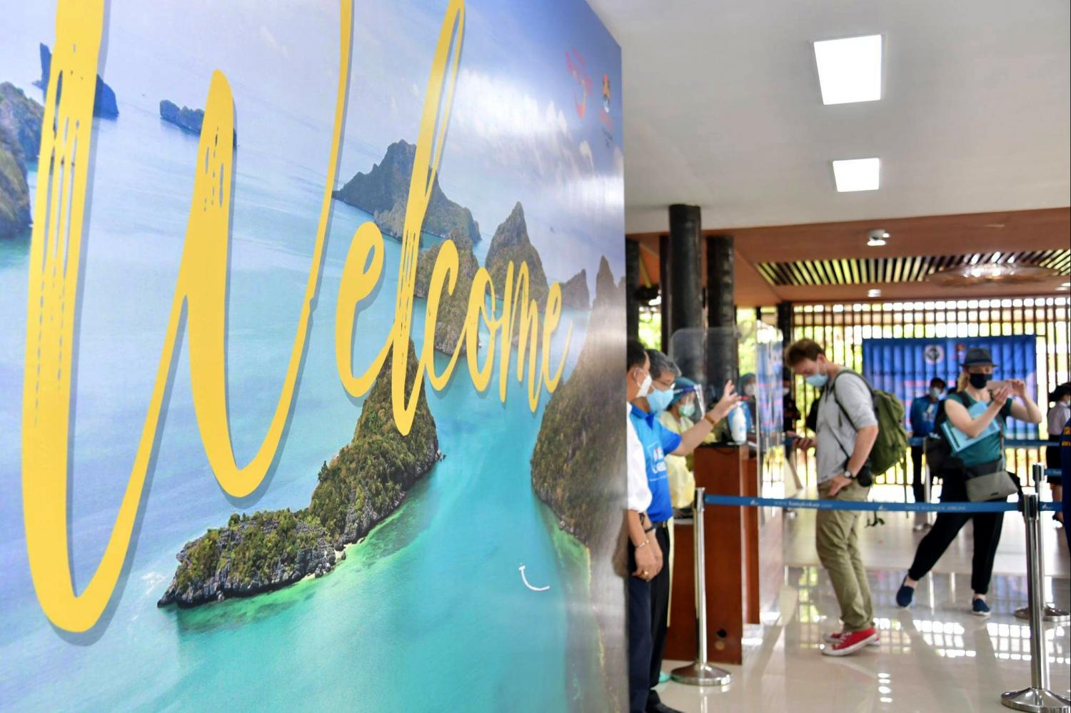 A welcome sign greets tourists arriving at Koh Samui under Samui Plus travel scheme. As of Monday, the island has received 621 tourists from the pilot programme.