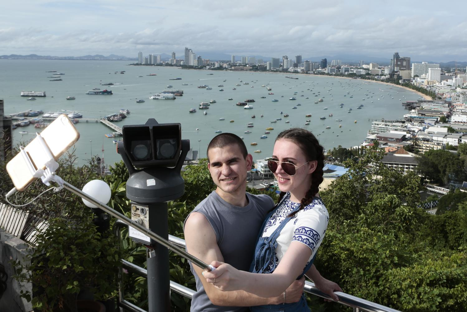 Tourists take a selfie at Pratumnak Hill Viewpoint overlooking Pattaya Bay prior to the pandemic.Patipat Janthong
