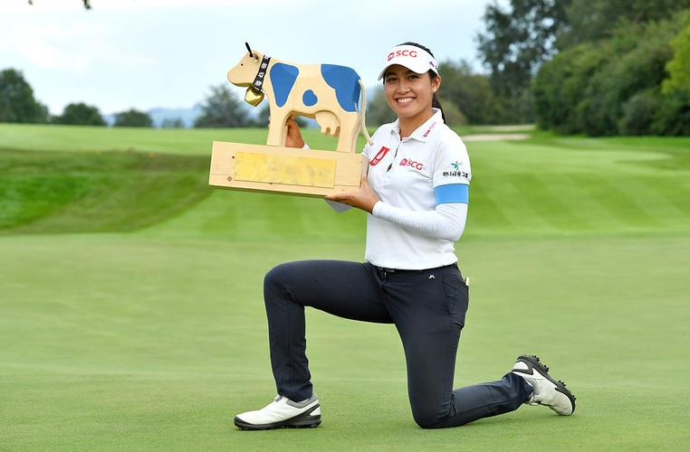 Atthaya Thitikul poses with the trophy after winning the Swiss Ladies Open.