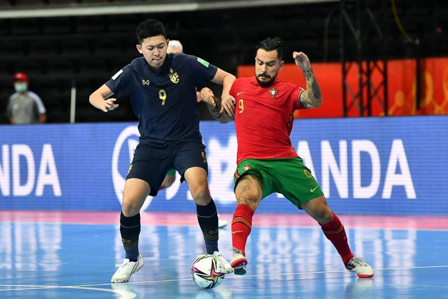 Thailand's Suphawut Thueanklang, left, vies with Portugal's Joao Matos.