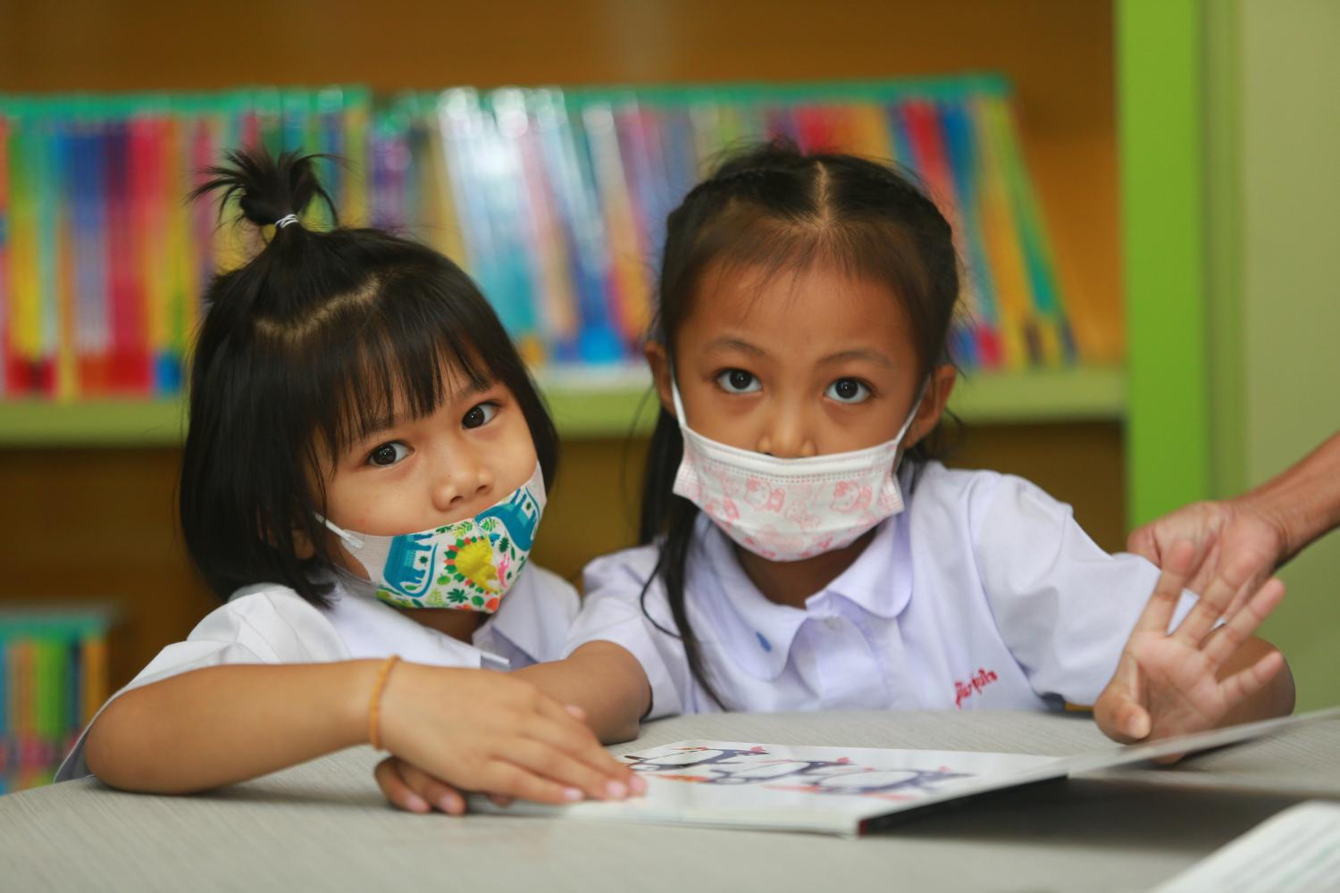 Young students read at the National Library. A new set of children's books appears to carry clear political messages.(Photo: Somchai Poomlard)