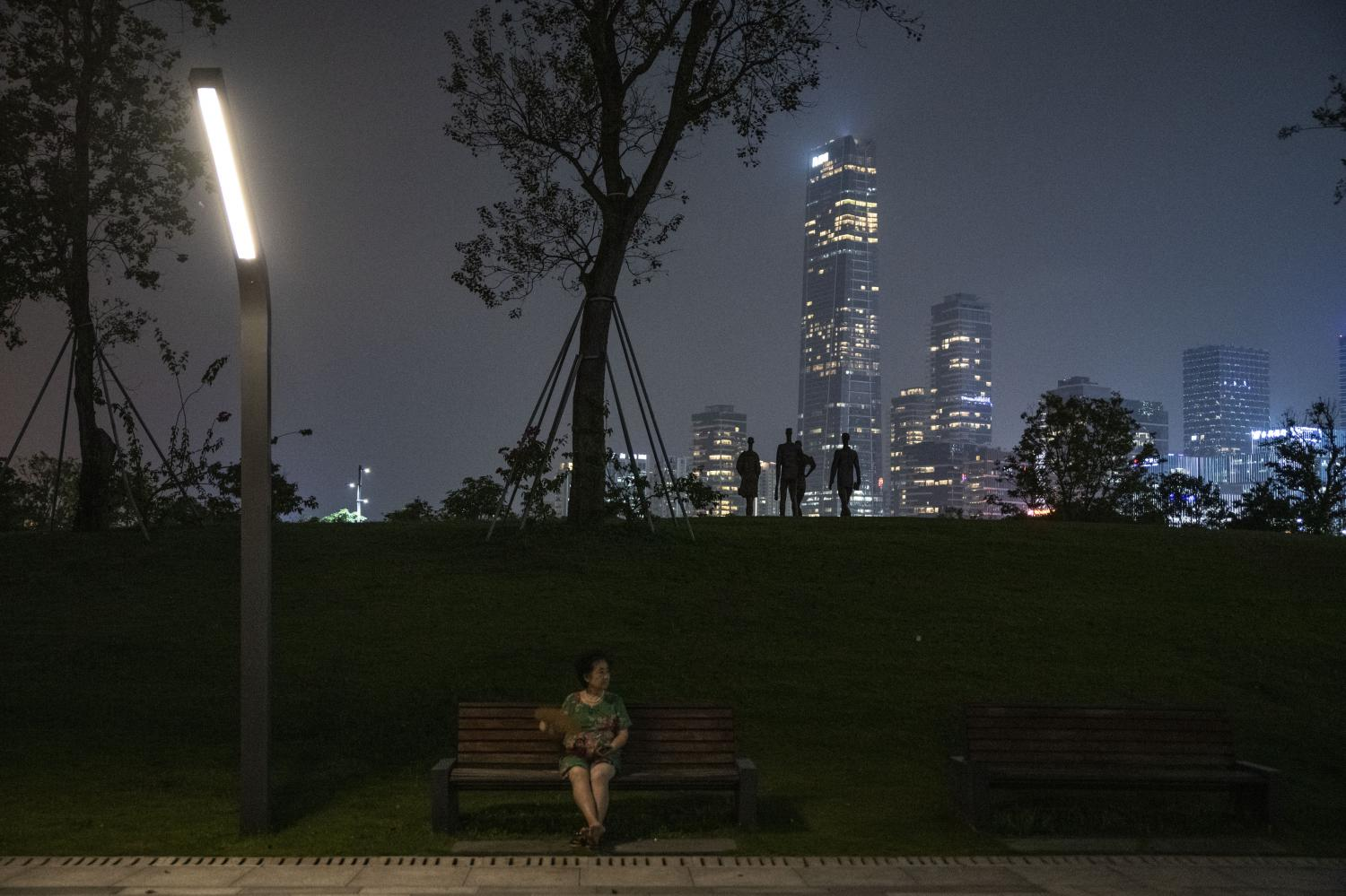 Visitors at a park in Shenzhen on Sept 30. Over 20 Chinese regions are facing electricity cuts as the nation's power crisis deepens. Bloomberg