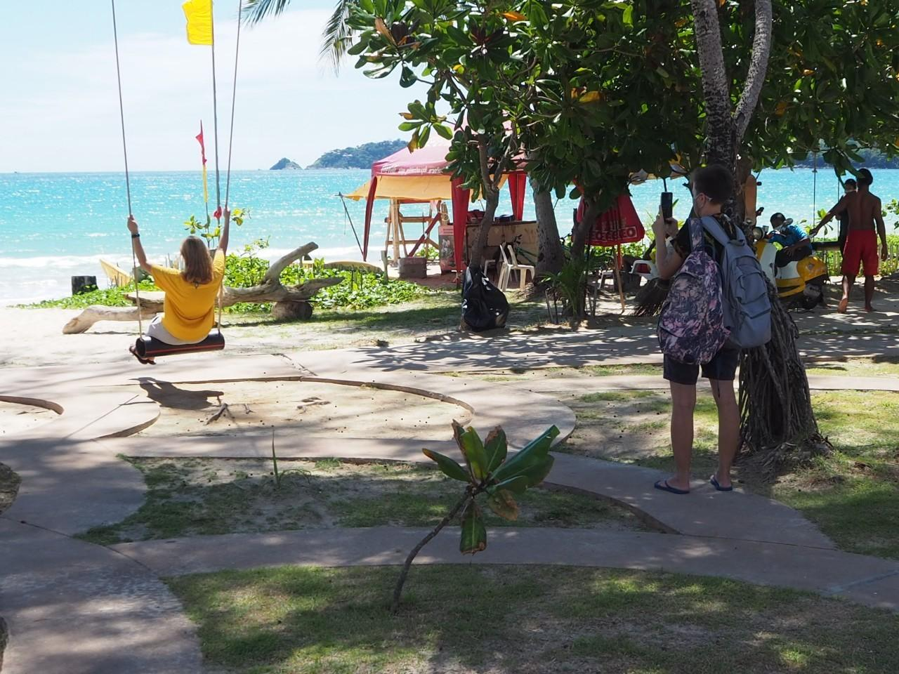 A tourist takes photos at Patong beach in Phuket, which has seen a gradual increase in tourists thanks to the Phuket sandbox programme.Dusida Worrachaddejchai