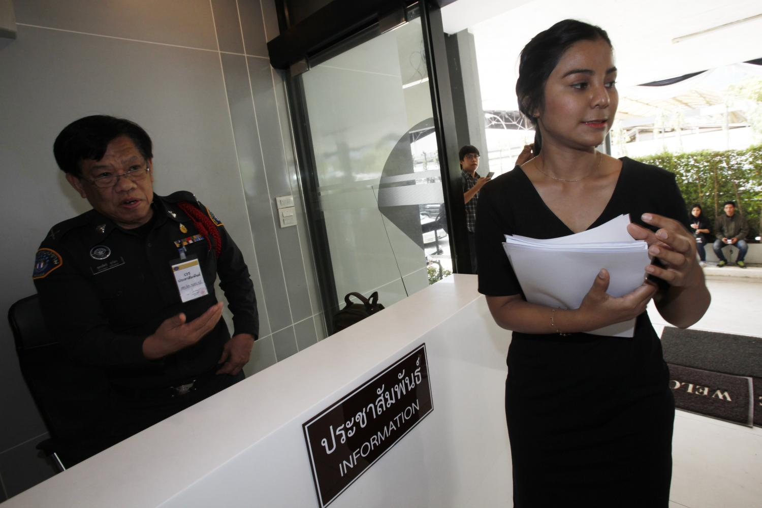 Narisarawan Kaewnopparat prepares to complain to the Crime Suppression Division in the November 2016 file photo, over the death of her uncle, Army Private Wichian Pueksom.