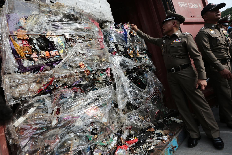 This 2018 photo shows police inspecting a shipment of hazardous waste at Laem Chabang port in Chon Buri.Wichan Charoenkiatpakul.