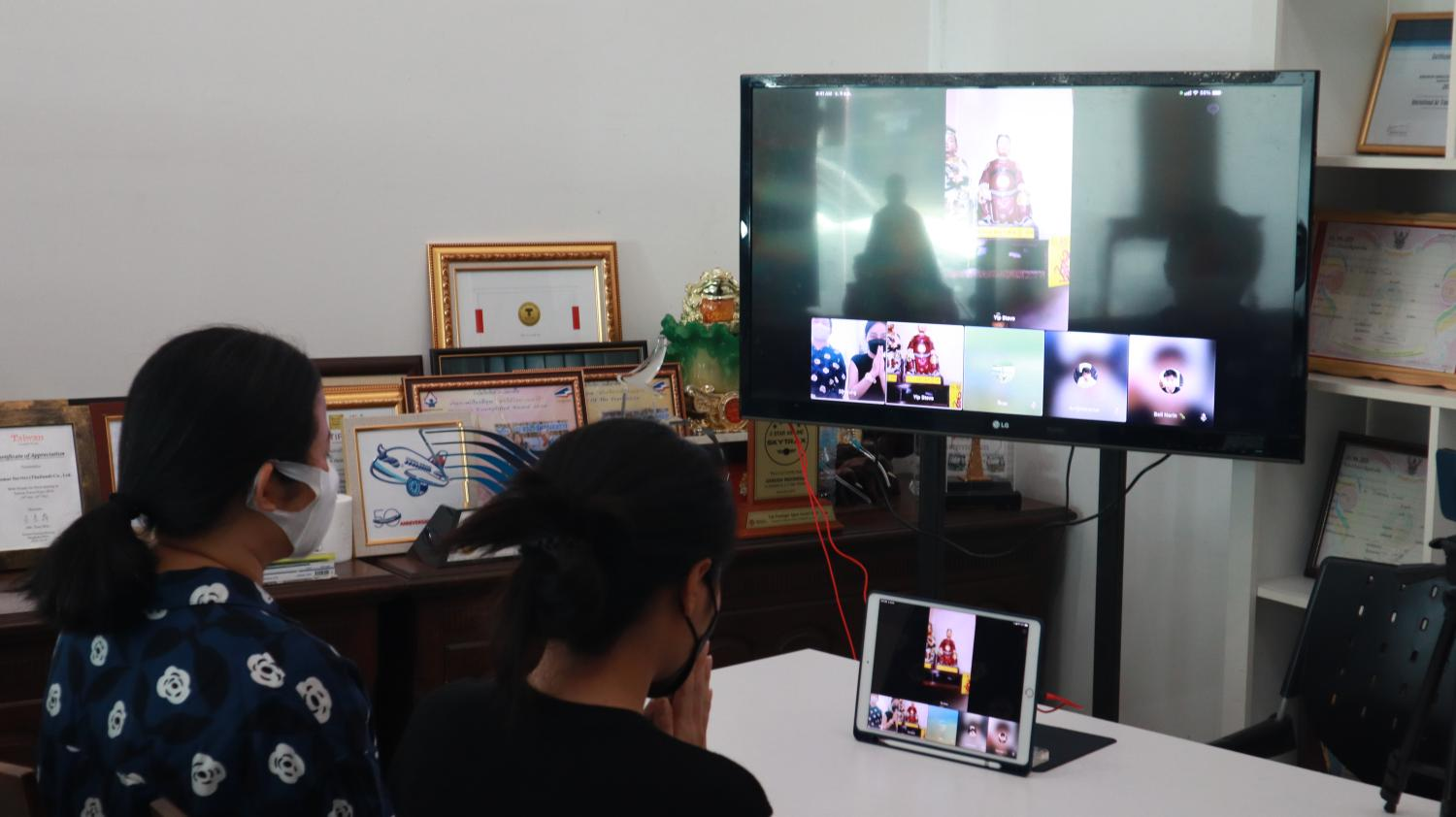 Thais pray for good fortune during an online spiritual tour at a famous temple in Hong Kong via video conference.